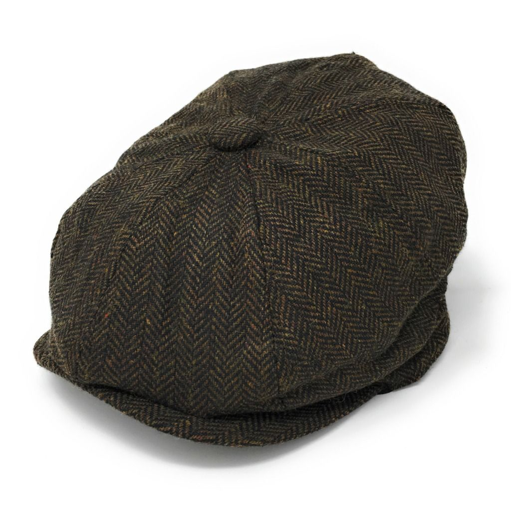 bfd4846a 8-piece cap with elastic back. Herringbone. Wool Blend
